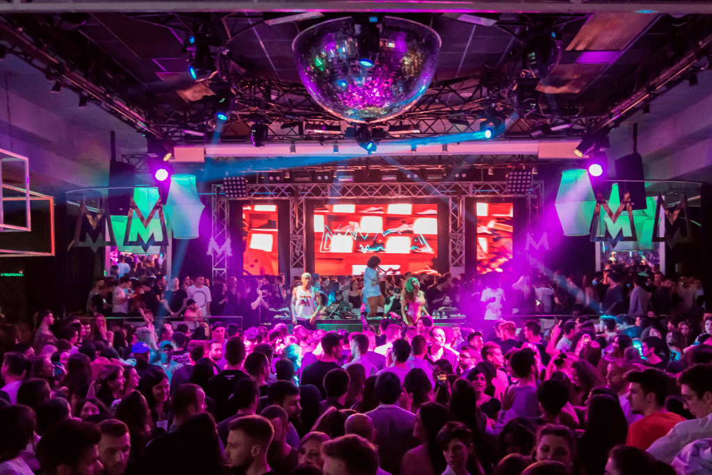 Performers and an audience at a night club