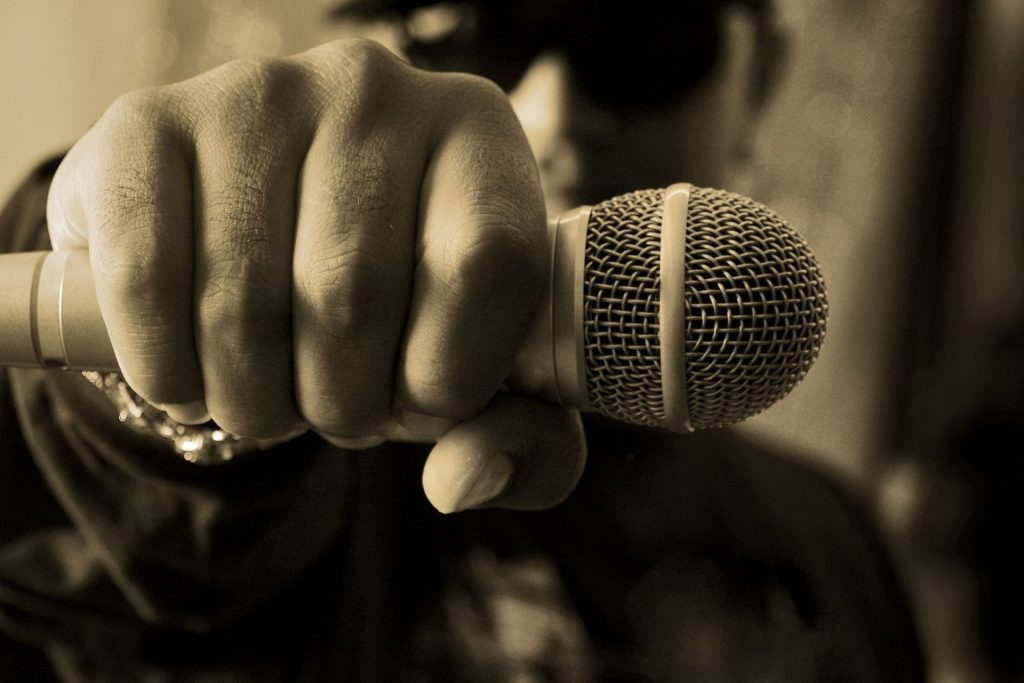 A person holding a microphone