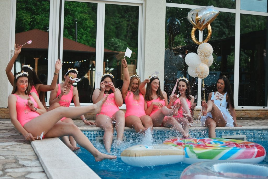 A group of women celebrate their Vegas bachelorette party by the pool