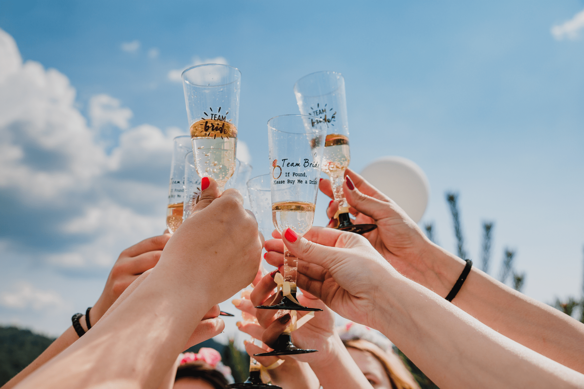 Bridesmaids cheers champagne flutes at a bachelorette party